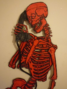 A red skeleton on the telephone