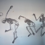 4 cut-out skeleton drawings.