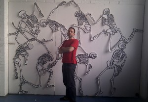 Me in front of a large group of skeleton drawings.