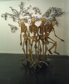 """Yellow Skeleton on stand"" and ""AK47"" drawings at the Ground Floor Left gallery."