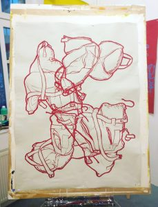 Drawing of a children's life jacket. Red oil pastel on light grey Gu